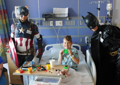 Super Heros Give Back To Childrens Hospital