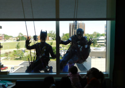 Kids Enjoy Super Heros Cleaning Windows