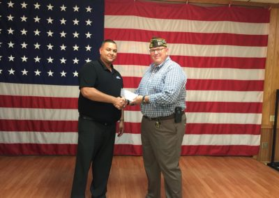 ANSI GM Dametric Burnett was pleased to present this check for $2500 to Bloomington, Illinois VFW Post 454 Commander Brent Wick